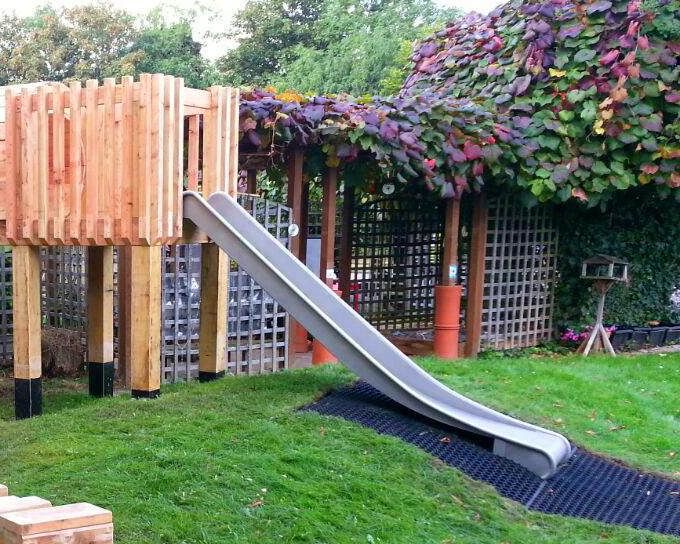 Metal playground slide side image
